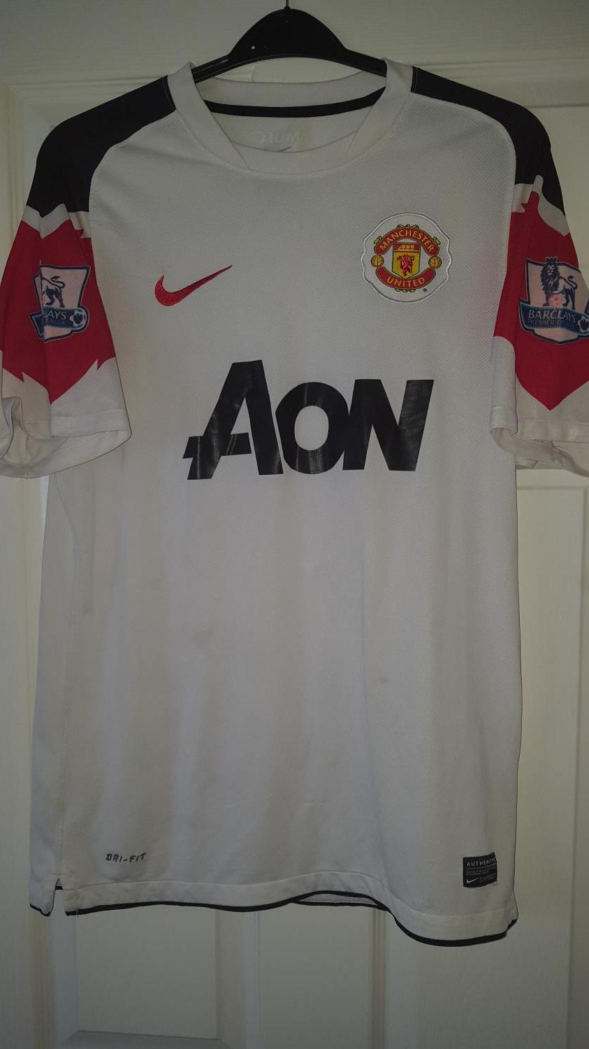 Manchester United Away football shirt 2010 - 2011. Sponsored by AON
