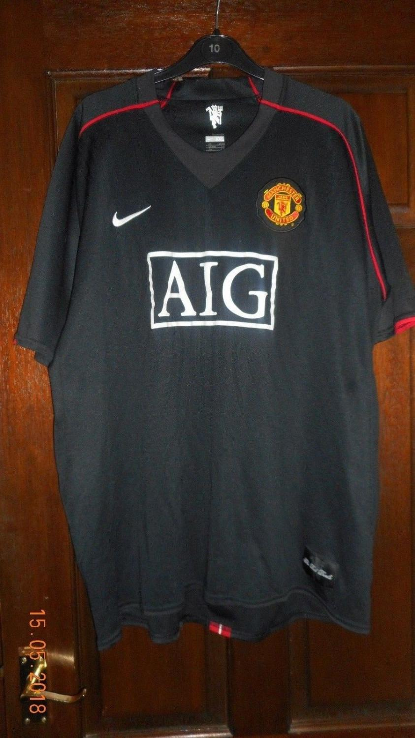 Manchester United Away football shirt 2007 - 2008. Sponsored by AIG
