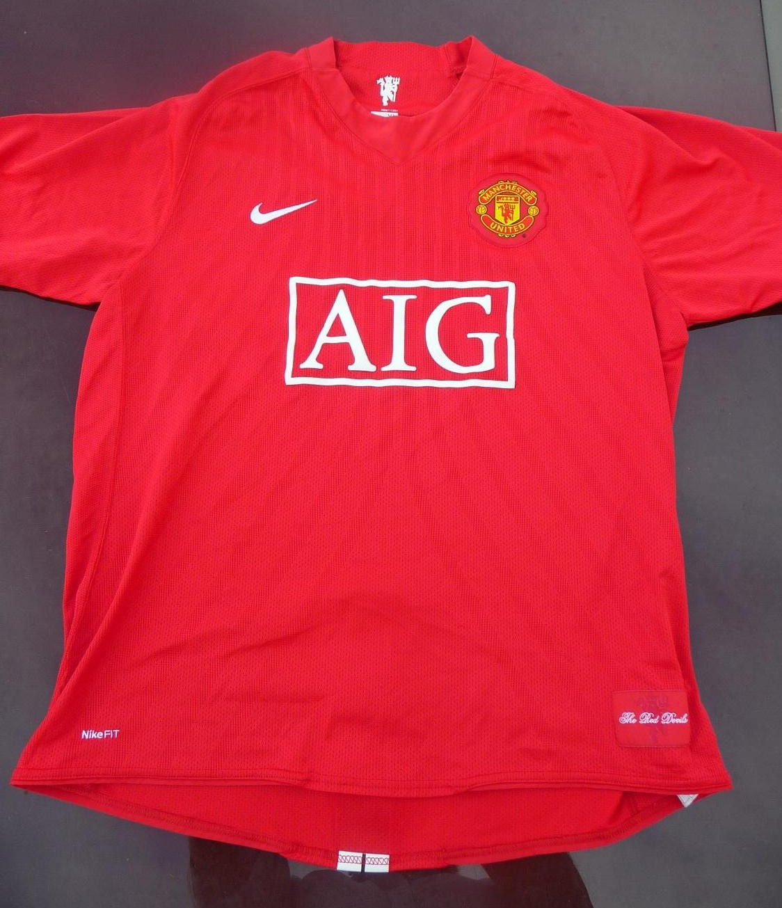 Manchester United Home football shirt 2007 - 2009. Sponsored by AIG