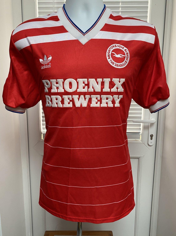 http://www.oldfootballshirts.com/img/shirts/50/brighton-and-hove-albion-away-football-shirt-1985-1986-s_10205_1.jpg